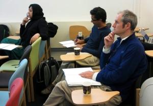 Nauman, Fayaz Alibhai and Nick Fuller listen and take notes as Blaise Cronin speaks