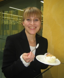 Maria Kronqvist-Berg enjoys a well-deserved slice of apple cake after the successful defence of her thesis