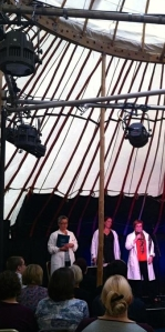 Clare, Pam, and Susan on stage in the yurt